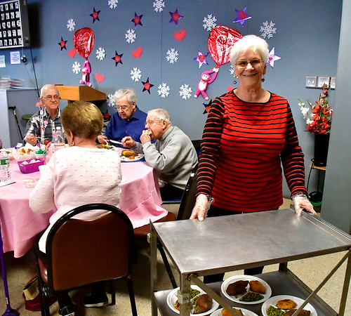 2/14/2019 Mike Orazzi | Staff Volunteer Rose Pelletier while serving Valentine's Day dinners to seniors at the Bristol Senior Center on Thursday. The menu included chicken cordon bleu, sweet potatoes, buttered peas and a dinner roll.