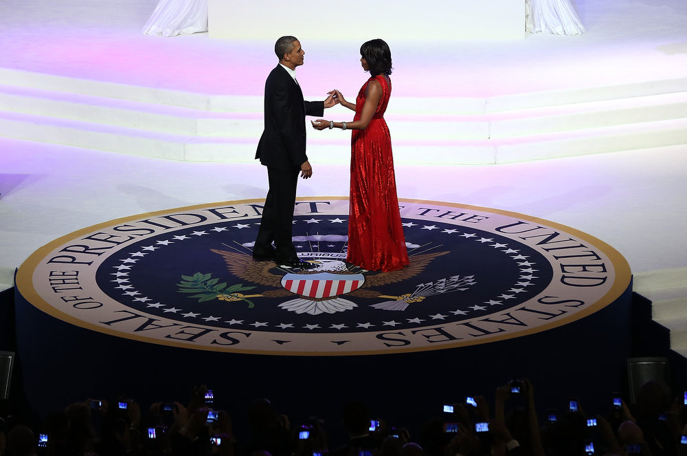 Description of . U.S. President Barack Obama (L) dances with first lady Michelle Obama at the Commander-in-Chief Ball on January 21, 2013 in Washington, DC. Pres. Obama was sworn-in for his second term as president during a public ceremonial inauguration earlier in the day.  (Photo by Justin Sullivan/Getty Images)