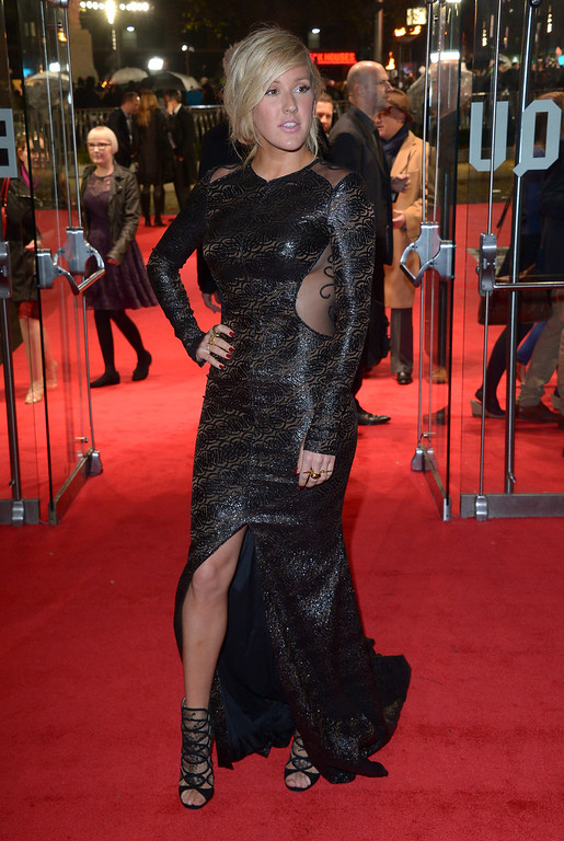 . Singer Ellie Goulding poses for photographers as she arrives for the World Premiere of \'The Hunger Games: Catching Fire\', on Monday Nov. 11, 2013, in Leicester Square, London. \'Catching Fire\' is the second installment in \'The Hunger Games\' trilogy. (Photo by Jon Furniss/Invision/AP)
