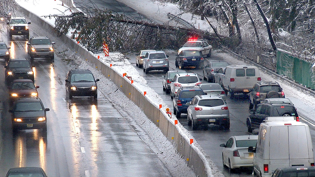 . Southbound traffic  backs up after a tree fell across U.S. 1 in Langhorne, Bucks County, Pa., Wednesday morning, Feb. 5, 2013. Traffic was stopped for over two hours. Icy condition ssnarled traffic and caused power outages Wednesday.  (AP Photo/Bucks County Courier Times,David Garrett )