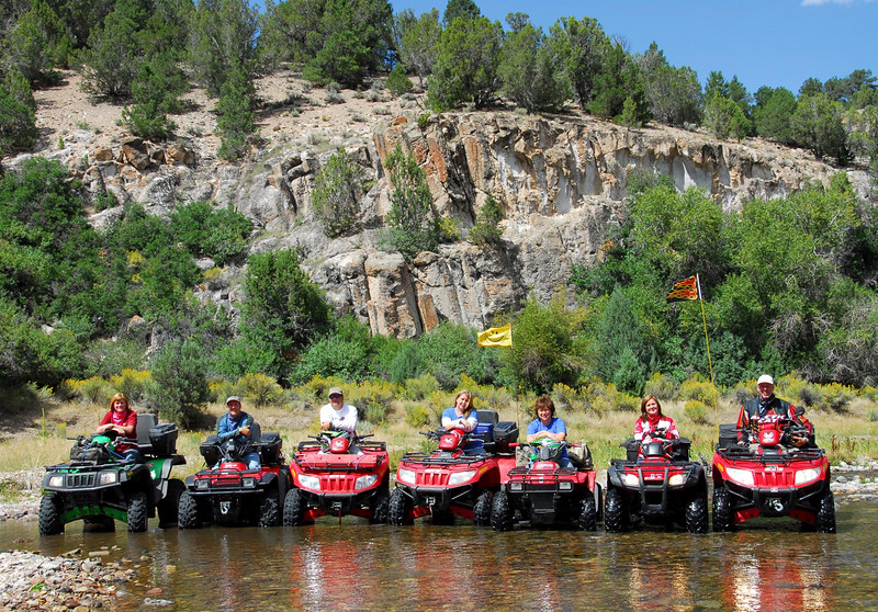 9/10/07 – I had to post one more photo from the trip. I'll post many more shortly in a gallery with just shots from the ride. This was our entire group less me. We had been splashing back and forth having a good time and I asked them to all line up in the river for a group shot.