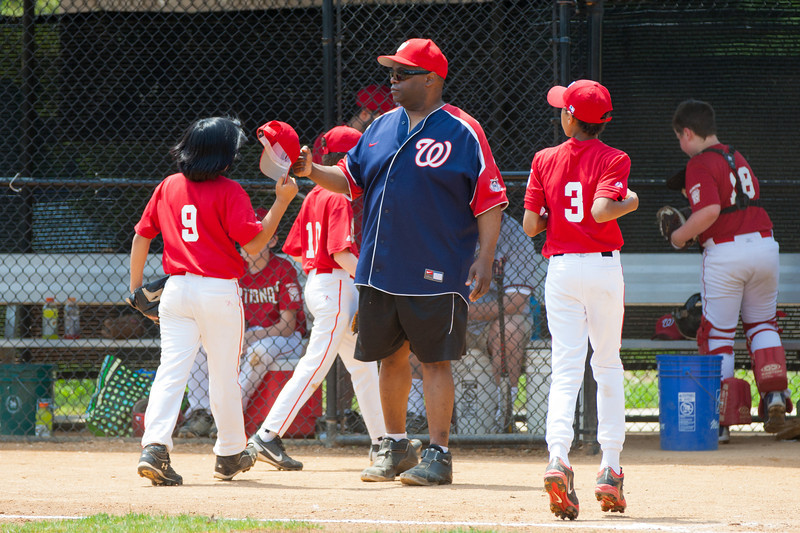 Coach Coop pleased to see how the Nats closed out the 3rd inning. The bats of the Nationals were supported by a great defensive outing in a 11-4 win over the Twins. They are now 7-3 for the season. 2012 Arlington Little League Baseball, Majors Division. Nationals vs Twins (13 May 2012) (Image taken by Patrick R. Kane on 13 May 2012 with Canon EOS-1D Mark III at ISO 400, f4.0, 1/1000 sec and 230mm)