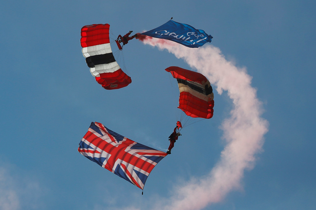 . The British Army\'s Parachute Regiment display team, the Red Devils, perform during the Farnborough International Air Show, Farnborough, England, Tuesday, July 15, 2014. (AP Photo/Sang Tan)