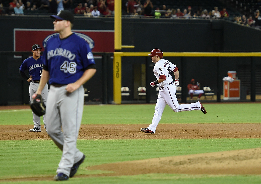 . Miguel Montero #26 of the Arizona Diamondbacks rounds the bases after hitting a first inning home run against the Colorado Rockies at Chase Field on August 8, 2014 in Phoenix, Arizona.  (Photo by Norm Hall/Getty Images)