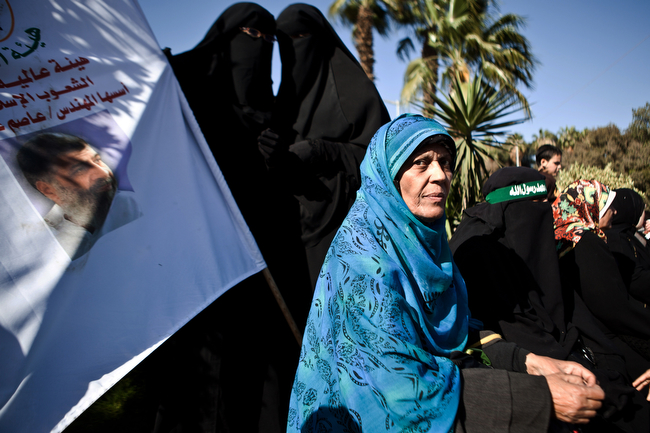 . Women attend a rally at Cairo University outside Cairo University in Cairo, Egypt, Friday, Feb. 15, 2013. Around 5,000 mostly hardline Islamists are rallying in Egypt against a recent wave of protests that has killed around 70 people. (AP/Virginie Nguyen Hoang)