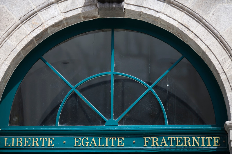 """The motto """"Liberte, Egalite, Fraternite"""" on the door of the City Hall, town of Quimper, departament of Finistere, region of Brittany, France"""