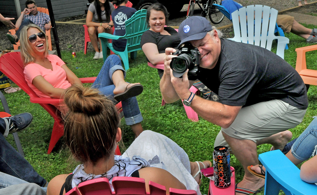 . Chris Edrington, the founder of St. Paul Sober Living, gets the right angle at a barbecue for residents, staff, friends, family and sponsors. Edrington focused on the �live with �em� part of recovery by starting a chin of sober houses for recovering abusers in the Twin Cities, totalling about 100 beds. (Pioneer Press: Jean Pieri)
