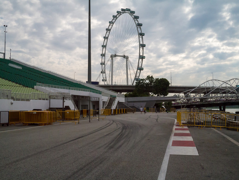 Part of the Singapore Grand Prix track with the Singapore Flyer in the background
