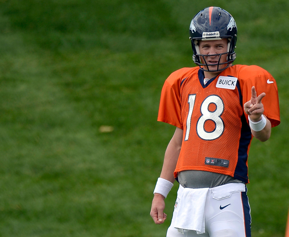 . Denver Broncos quarterback Peyton Manning (18) conducts drills during practice September 19, 2013 at Dove Valley. (Photo by John Leyba/The Denver Post)