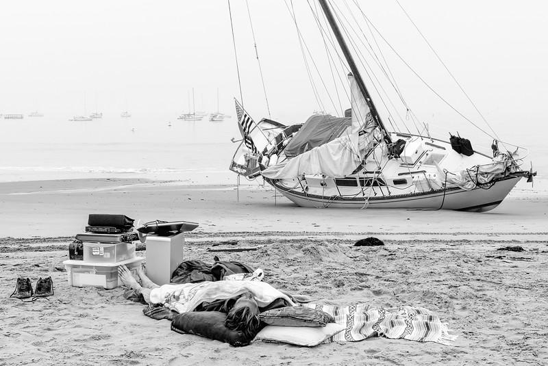 NSBC-D0009 Owner Sleeps Beached Sailboat.jpg