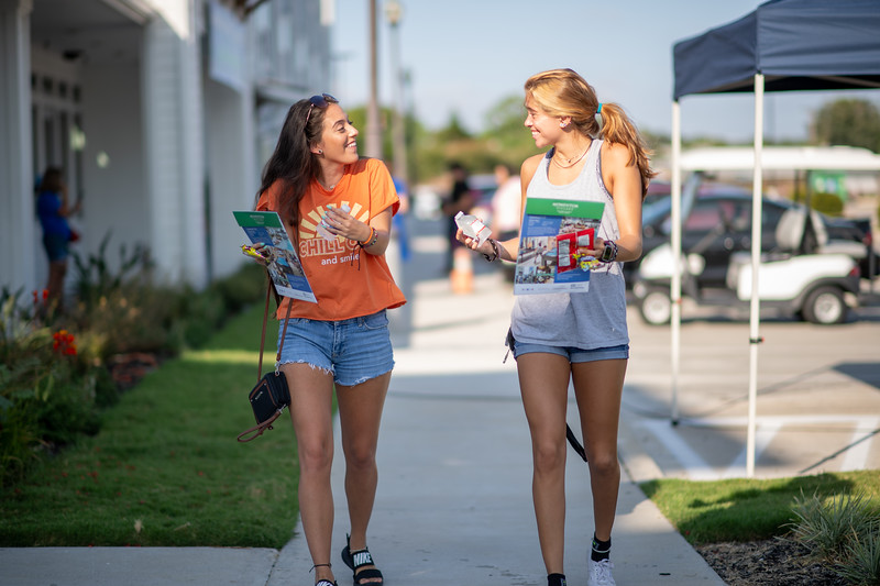 Students Amelia Moreno (left), and Sophia Moreno make their way to their rooms on move in day.