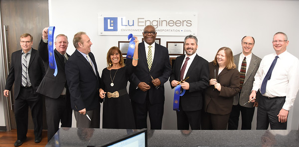 Officials welcome Lu Engineers to East Avenue. 12/5/2016