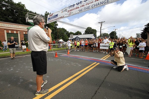 Kevin Bartram | Staff\nDr. William A. Petit Jr. speaks to runners before the start of the GE Petit Family Foundation Road Race 5K on Sunday in Plainville.