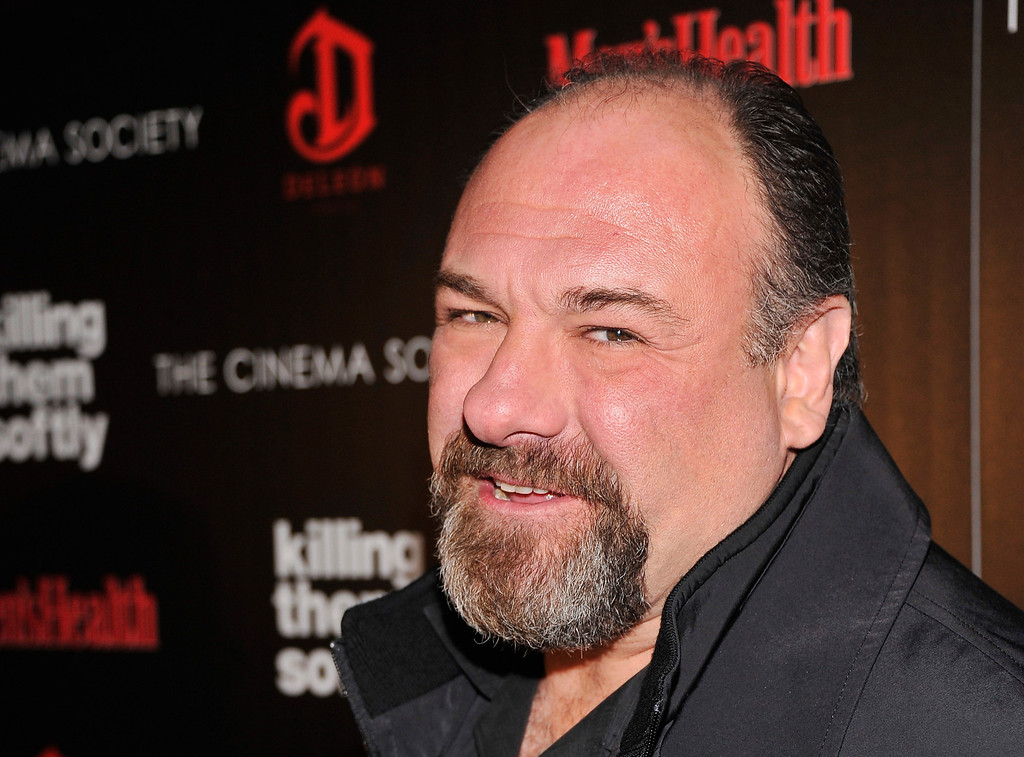 """. Actor James Gandolfini attends The Cinema Society with Men\'s Health and DeLeon hosted screening of The Weinstein Company\'s \""""Killing Them Softly\"""" on November 26, 2012 in New York City.  The actor died Wednesday, June 19, 2013, in Italy. He was 51. (Photo by Stephen Lovekin/Getty Images)"""