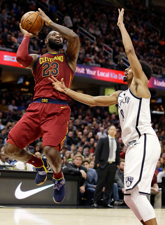 . Cleveland Cavaliers\' LeBron James (23) drives to the basket against Brooklyn Nets\' Spencer Dinwiddie (8) during the second half of an NBA basketball game, Wednesday, Nov. 22, 2017, in Cleveland. The Cavaliers won 119-109. (AP Photo/Tony Dejak)