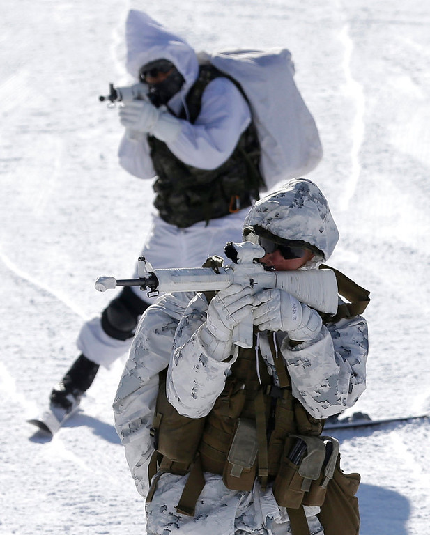 . A U.S. Marine from 3-Marine Expeditionary Force 1st Battalion from Kaneho Bay, Hawaii, front, and a South Korean Marine aim their guns during their joint military winter exercise in Pyeongchang, east of Seoul, South Korea, Thursday, Feb. 7, 2013. More than 400 marines from the two countries participated in the Feb. 4-22 joint winter exercise held for the first time in South Korea. (AP Photo/Lee Jin-man)