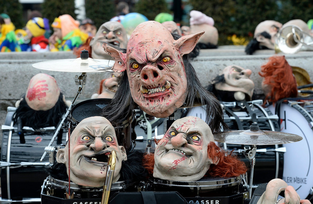 . Masks are laid out prior to the great parade through the streets of the city during the start of the carnival season in Lucerne, Switzerland, 27 February 2014.  EPA/URS FLUEELER