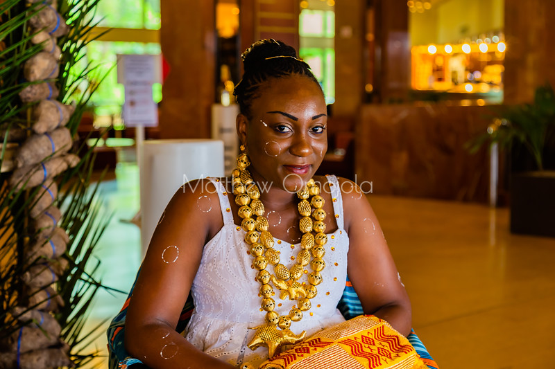 African ivorian culture on display at the president hotel Yamoussoukro. Young Ivorian lady wearing traditional african dress with gold jewelry. Promoting culture. Body decoration on the lady, African hairstyle,