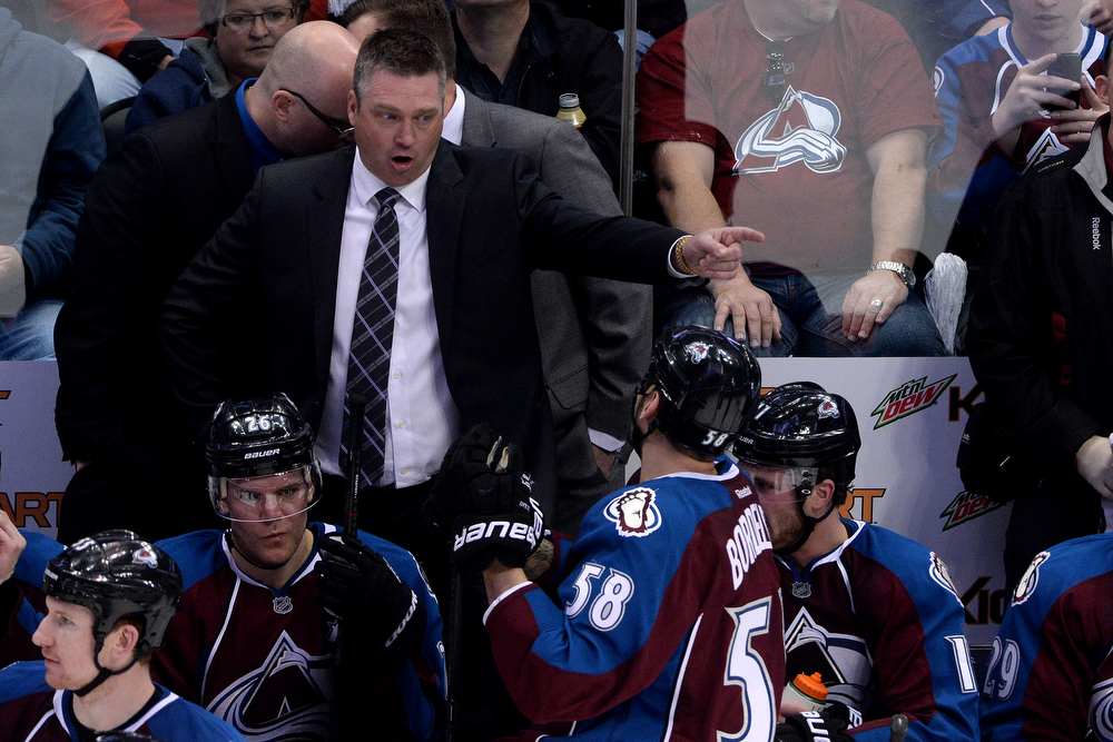 . Patrick Roy of the Colorado Avalanche speaks with Patrick Bordeleau (58) as they play against the Minnesota Wild during the second period of action. The Colorado Avalanche hosted the Minnesota Wild in the first round of the NHL playoffs at the Pepsi Center on Thursday, April 17, 2014. (Photo by Karl Gehring/The Denver Post)