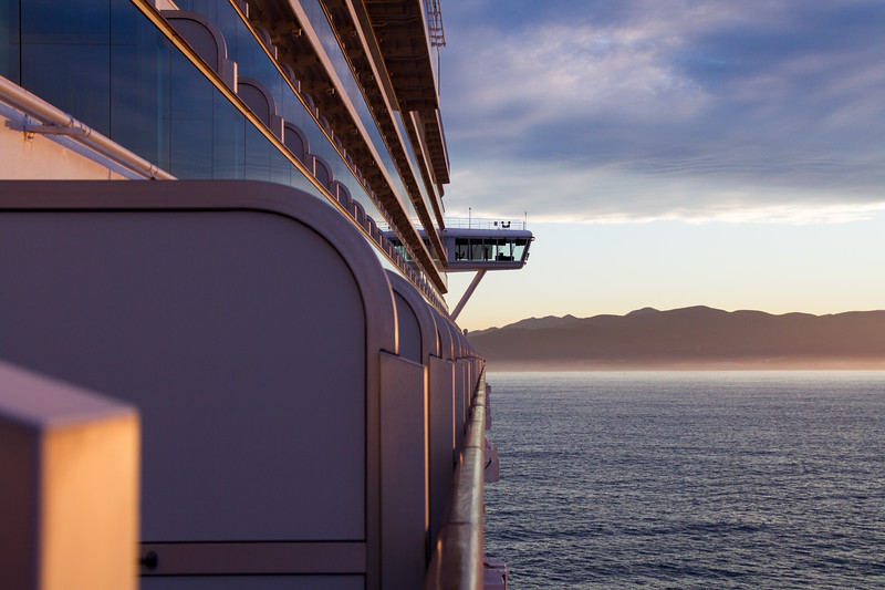 Looking down the side of a large cruise ship