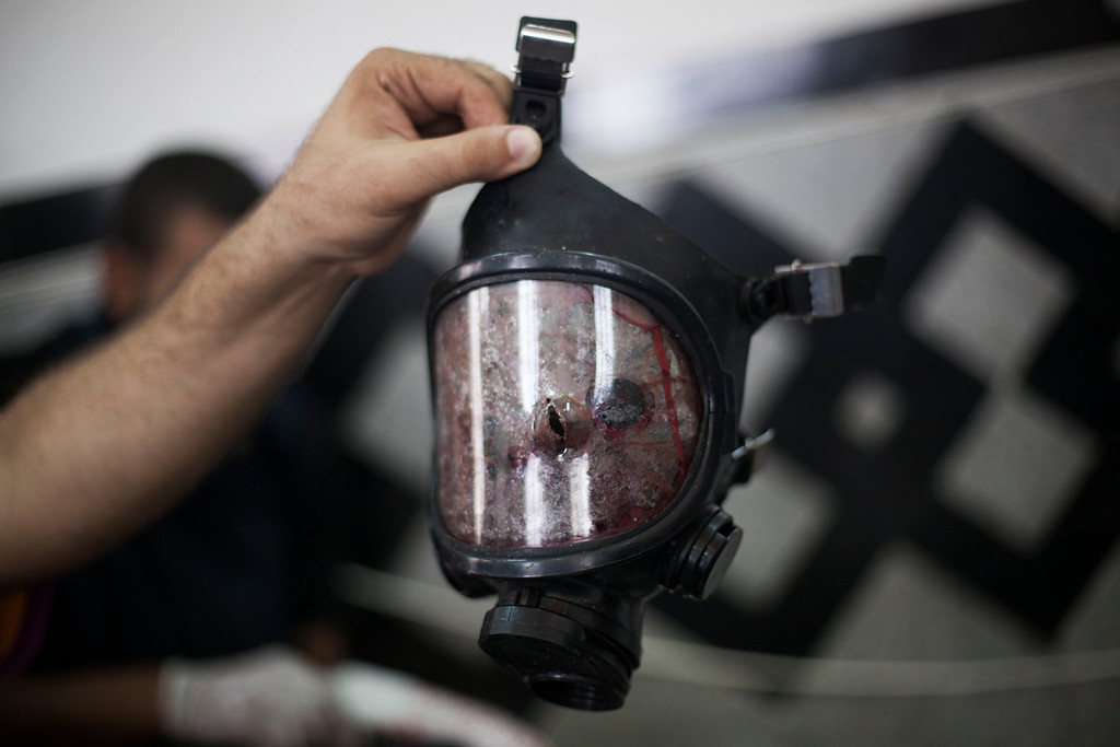 . A bullet hole is seen in the front of a gas mask belonging to a supporter of ousted Egyptian President Mohammed Morsi in Cairo\'s Nasr City district, Egypt, Wednesday, Aug. 14, 2013.  (AP Photo/Manu Brabo)
