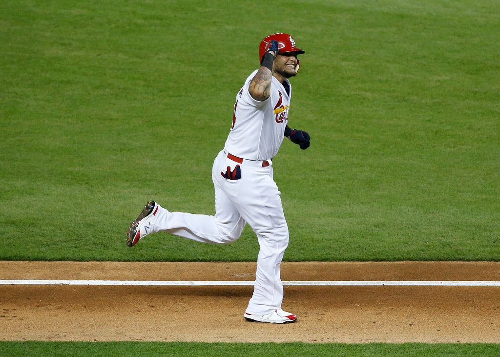 . National League\'s St. Louis Cardinals catcher Yadier Molina (4), rounds the bases after hitting a homerun in the sixth inning, during the MLB baseball All-Star Game, Tuesday, July 11, 2017, in Miami. (AP Photo/Wilfredo Lee)