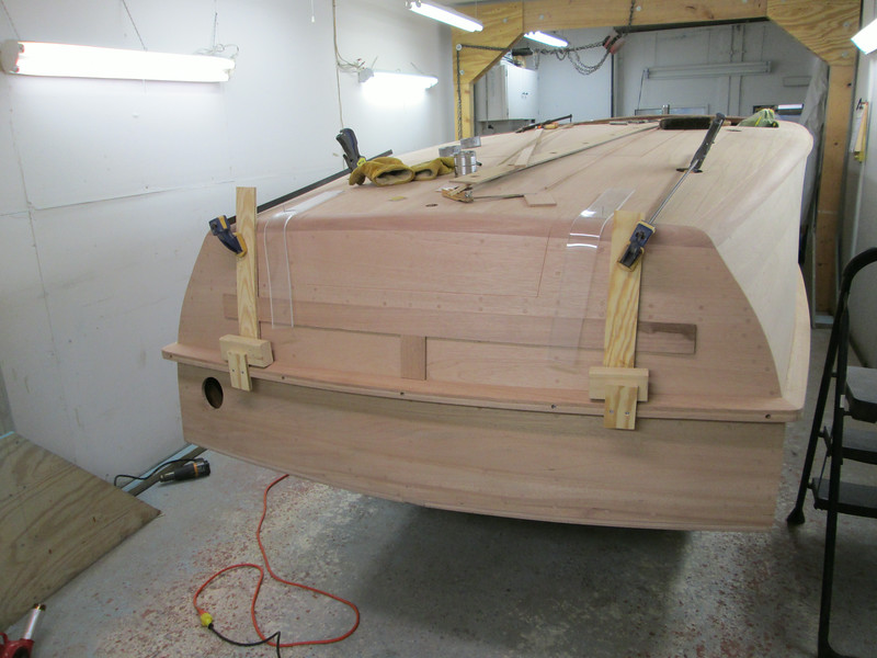 Fabricated router jig for the transom with the seam routed.