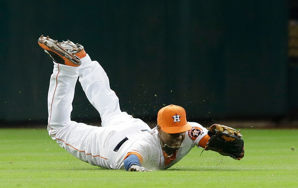 . Houston Astros left fielder L.J. Hoes makes a diving catch for the out on Detroit Tigers\' Ian Kinsler to end the top of the seventh inning with the bases loaded in a baseball game Saturday, June 28, 2014, in Houston. (AP Photo/Pat Sullivan)
