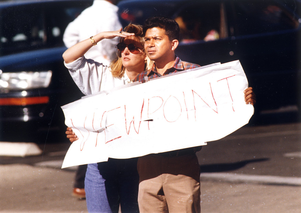 . Parent Betty Saleman and teacher Asif Azhar during evacuation of students fro mthe Viewpoint School.  (11/3/93)   Los Angeles Daily News file photo