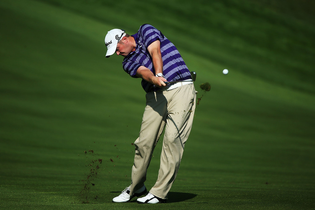 . ROCHESTER, NY - AUGUST 08:  Jason Kokrak of the United States hits an approach shot on the tenth hole during the first round of the 95th PGA Championship on August 8, 2013 in Rochester, New York.  (Photo by Andrew Redington/Getty Images)