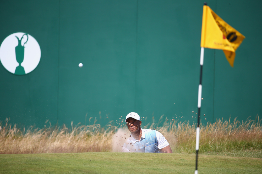 . Tiger Woods of the United States hits from a greenside bunker on the 18th hole during the first round of The 143rd Open Championship at Royal Liverpool on July 17, 2014 in Hoylake, England.  (Photo by Matthew Lewis/Getty Images)