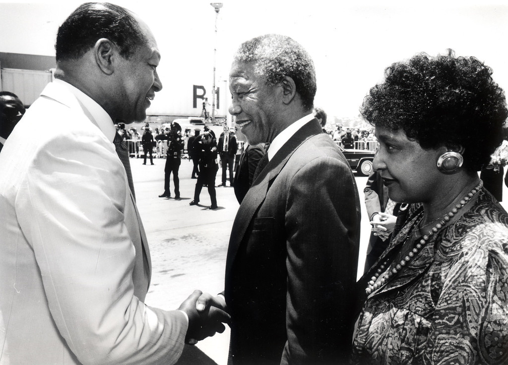 . 6/29/90: Mayor Tom Bradley greets Nelson Mandela and his wife, Winnie, upon their arrival at LAX.  Daily News file photo