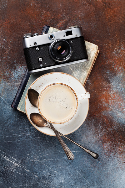 Coffee cup and retro camera
