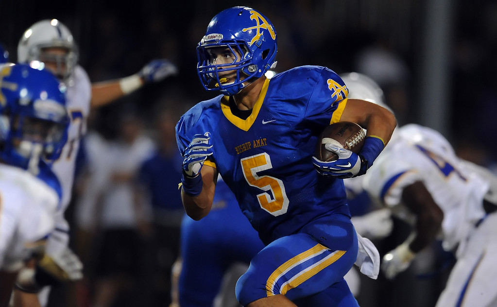 . Bishop Amat\'s Anthony Camargo (C) (5) runs for a first down against Charter Oak in the first half of a prep football game at Bishop Amat High School in La Puente, Calif. on Friday, Sept. 20, 2013.    (Photo by Keith Birmingham/Pasadena Star-News)