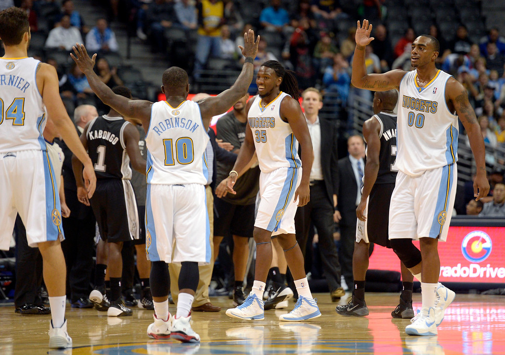 . DENVER, CO - OCTOBER 14: Denver Nuggets point guard Nate Robinson (10) Denver Nuggets power forward Darrell Arthur (00) and Denver Nuggets small forward Kenneth Faried (35) celebrate their lead late int he fourth quarter against the San Antonio Spurs October 14, 2013 at Pepsi Center. (Photo By John Leyba/The Denver Post)