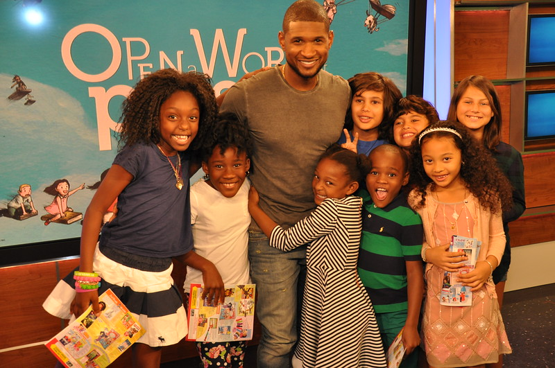 "Usher reads to kids for Scholastic's ""Open a World of Possible"" campaign at the NBC Universal studios on September 5, 2014.  Photo by Cynthia Carris/Photo Solutions NYC/Scholastic, Inc."