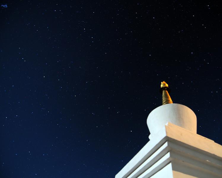 Tibetan stupa at Thiksey monastery at night.