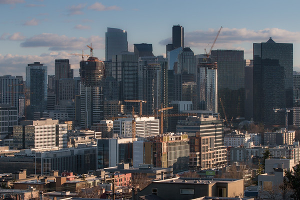 Seattle, at the end of 2017 was proclaimed by some to be the leader in a tight race with cities in the Southeast, as the fastest growing metro area in the US. At the beginning of 2018 62 construction cranes were swing their loads over the skyline, about 60 percent more cranes than any other U.S. city. Its hard to keep accurate current statistics but at the beginning of 2017 there were a total of 68 active construction projects underway, with a total of 110 major developments due to open in the next couple of years and dozens more on the drawing board. All this growth is providing employment for a small army of construction works and office space for some 40,000 Amazon employees among other professional workers. As a consequence of Amazon hiring and that by other companies in a burgeoning economy, the population within the city limits alone has risen by over 20 percent in the last seven years. The high paying jobs have had consequences good and bad but one thing is for sure; Seattle is no longer the provincial city tucked off in the corner of the country but has become an economic and technological powerhouse.  None of the tall buildings in the middle range of the picture existed six years ago.