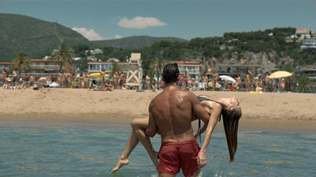 """. This  screenshot provided by Axe shows the Super Bowl advertisement for Axe. Axe\'s 30-second ad in the third quarter of the game shows a woman in the ocean getting rescued by a sexy lifeguard, but going for an astronaut instead. It promotes Axe\'s new cologne \""""Apollo\"""" and its contest to send someone on the first suborbital space tour in 2014. (AP Photo/Axe)"""