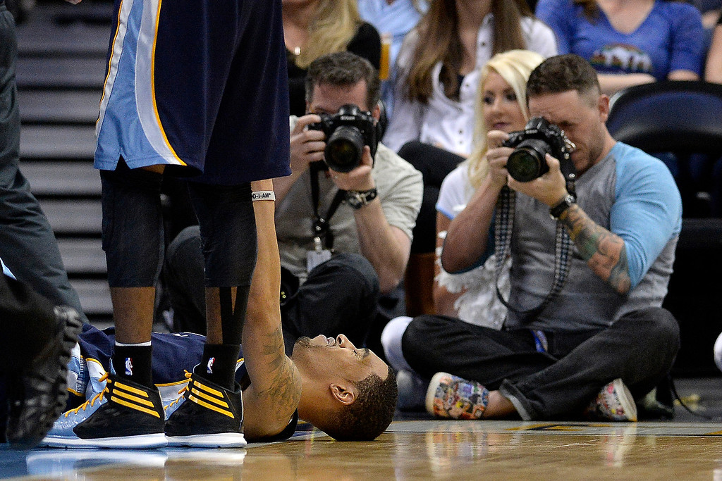 . Memphis Grizzlies guard Courtney Lee (5) lays on the ground after fouling Denver Nuggets guard Ty Lawson (3) hard during the fourth quarter of the Grizzlies\' 94-92 win. (Photo by AAron Ontiveroz/The Denver Post)