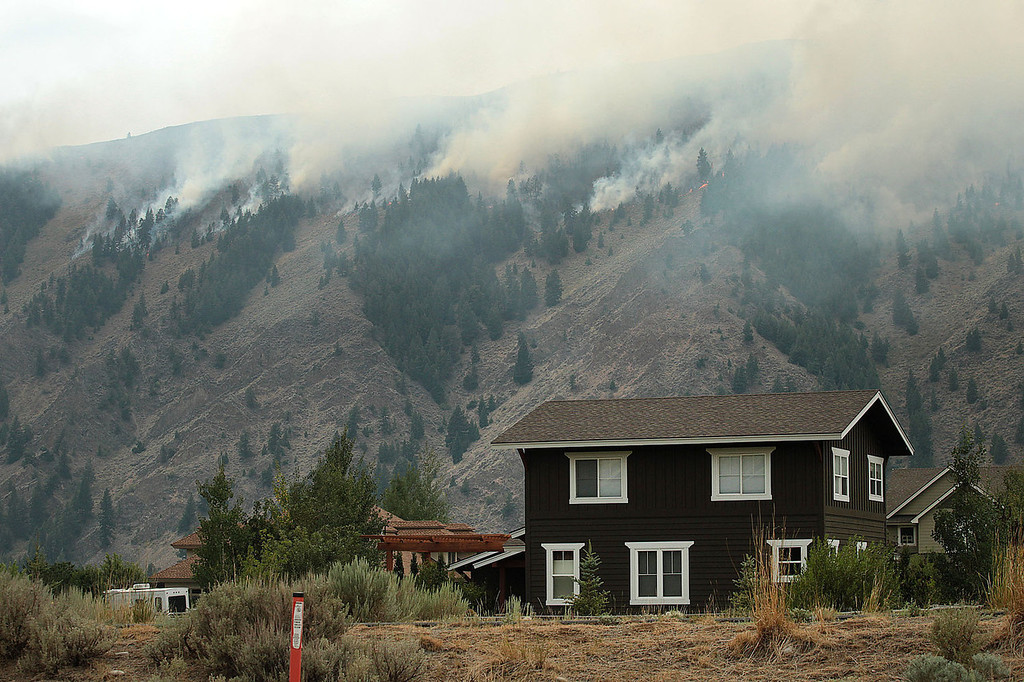 . Flames roll down a ridge from the Beaver Creek Fire on Saturday, Aug. 17, 2013 north of Hailey, Idaho.(AP Photo/Times-News, Ashley Smith)