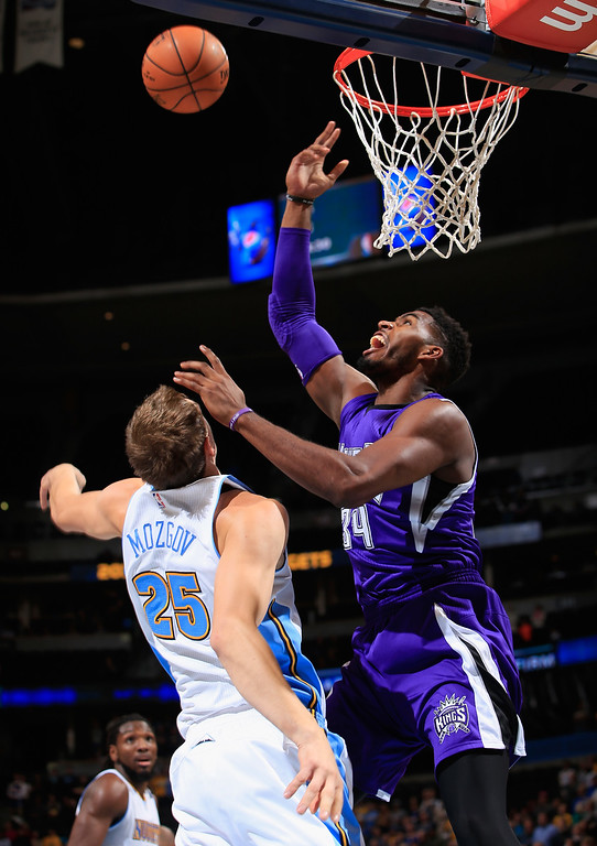 . DENVER, CO - NOVEMBER 03:  Timofey Mozgov #25 of the Denver Nuggets and Jason Thompson #34 of the Sacramento Kings vie for a rebound at Pepsi Center on November 3, 2014 in Denver, Colorado. NOTE TO USER: User expressly acknowledges and agrees that, by downloading and or using this photograph, User is consenting to the terms and conditions of the Getty Images License Agreement.  (Photo by Doug Pensinger/Getty Images)