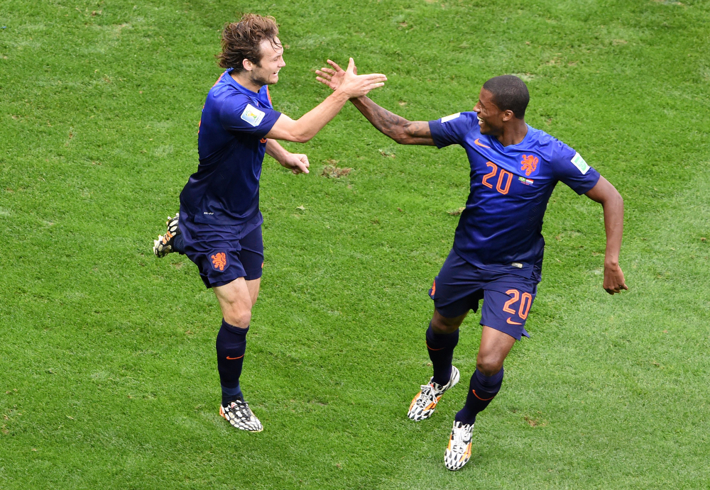 . Netherlands\' defender Daley Blind (L) celebrates with is teammate Netherlands\' midfielder Georginio Wijnaldum after scoring a goal during the third place play-off football match between Brazil and Netherlands during the 2014 FIFA World Cup at the National Stadium in Brasilia on July 12, 2014. (EVARISTO SA/AFP/Getty Images)