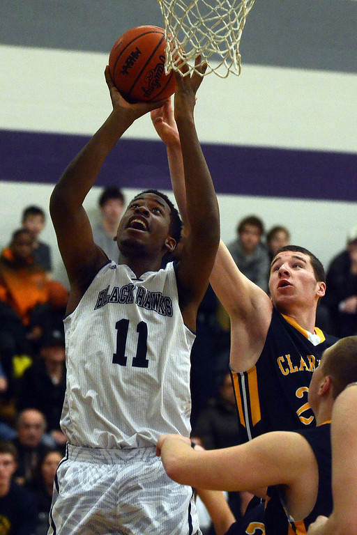 . Bloomfield Hills #11 Yante Maten goes up for a shot while guarded by Clarkston\'s #25 Michael Nicholson during their game at Bloomfield Hills High School, Tuesday January 28, 2014. Bloomfield Hills went on to win the game 74-62. (Vaughn Gurganian-The Oakland Press)