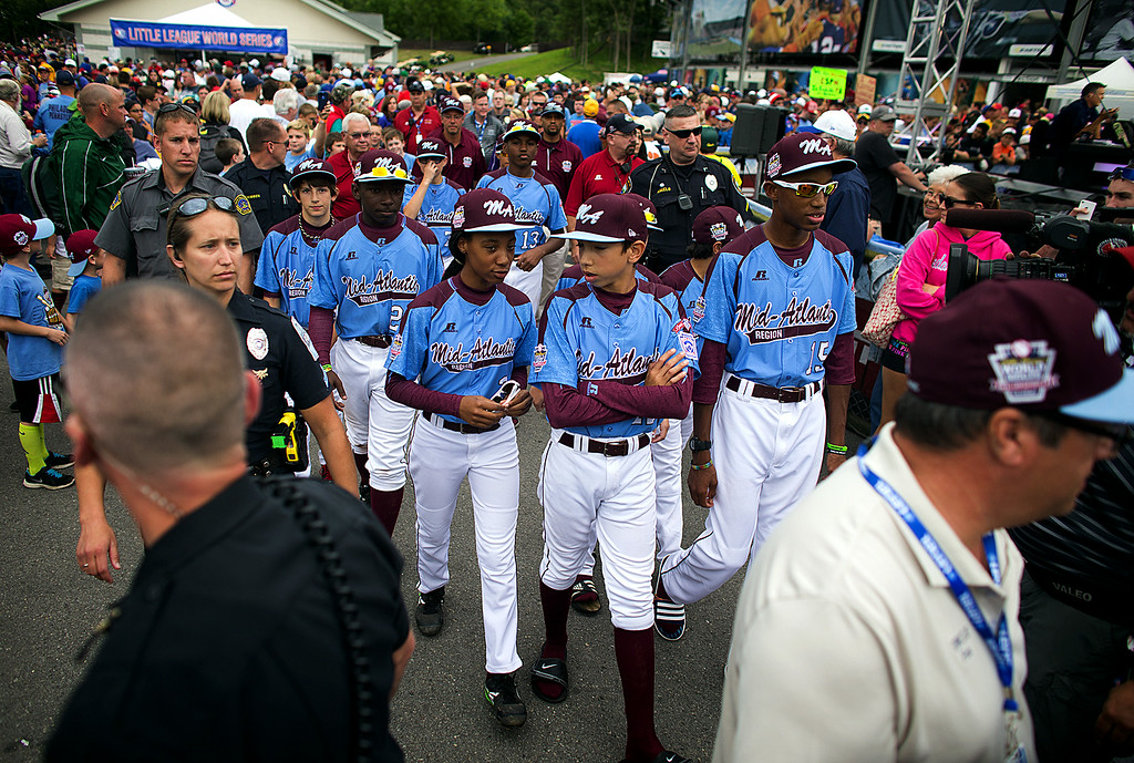 . Philadelphia\'s Mo\'ne Davis, center left, and Jared Sprague-Lott make their way to be interviewed after the team\'s 4-0 win over Nashville in a U.S. pool play baseball game at the Little League World Series, Friday, Aug. 15, 2014, in South Williamsport, Pa. (AP Photo/PennLive.com, Sean Simmers)