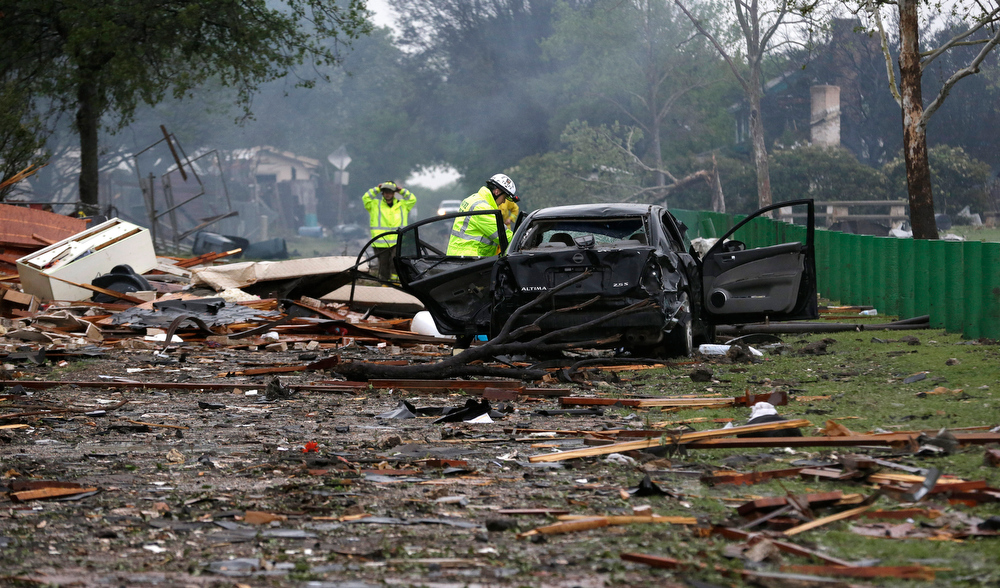 . Firefighter conduct search and rescue the the blast zone destroyed by an explosion at a fertilizer plant in West, Texas, Thursday, April 18, 2013.   A massive explosion at the West Fertilizer Co. killed as many as 15 people and injured more than 160, officials said overnight.  (AP Photo/LM Otero)