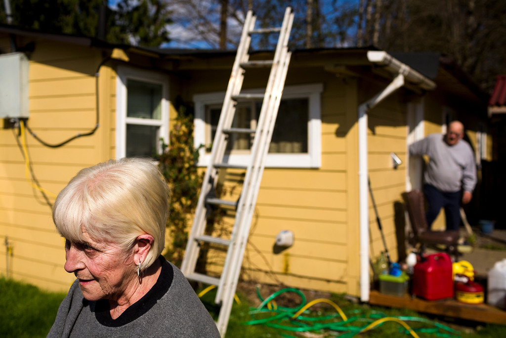 . Oso, Wash. residents Freda Slack, left, and husband Pat, right, evacuated Saturday, but returned home after hearing of decreased flooding risk Sunday, March 23, 2014.  (AP Photo/seattlepi.com, Jordan Stead)