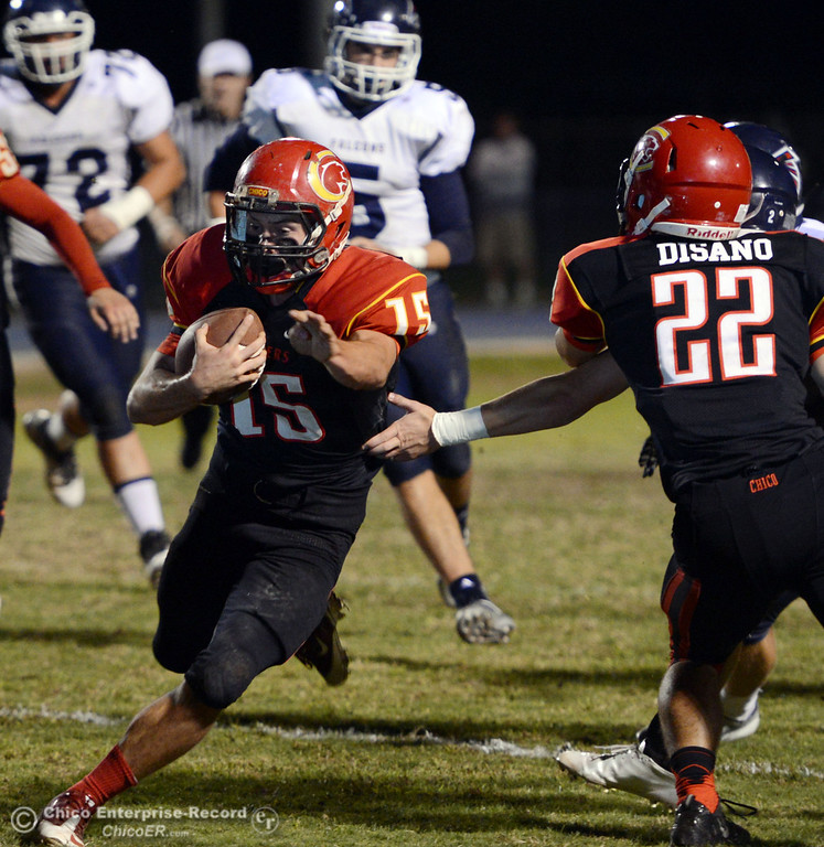 . Chico High\'s #15 Miles Fishback rushes against Central Valley High in the first quarter of their football game at Asgard Yard Friday, September 27, 2013, in Chico, Calif.  (Jason Halley/Chico Enterprise-Record)