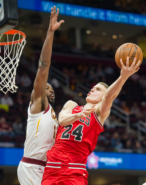 . Chicago Bulls\' Lauri Markkanen (24) shoots around Cleveland Cavaliers\' Tristan Thompson during the second half of an NBA preseason basketball game in Cleveland, Tuesday, Oct. 10, 2017. The Bulls won 108-94. (AP Photo/Phil Long)
