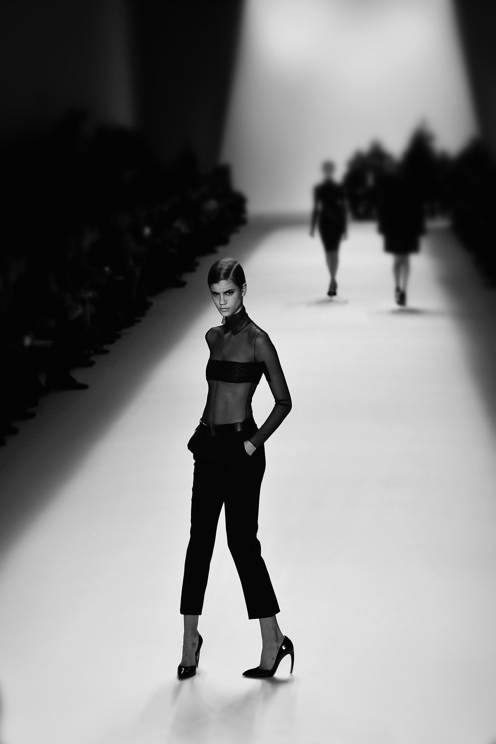 . A model walks the runway during the Akris Fall/Winter 2013 Ready-to-Wear show as part of Paris Fashion Week on March 3, 2013 in Paris, France.  (Photo by Gareth Cattermole/Getty Images)